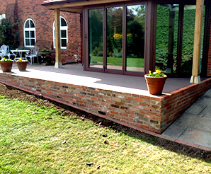 Sleeper and brickwork retaining walls